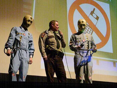 Anna Kurth Minnesota State Trooper Todd Lindstrom and the Crash Test Dummies tell Hibbing High School students about the importance of paying attention while driving.